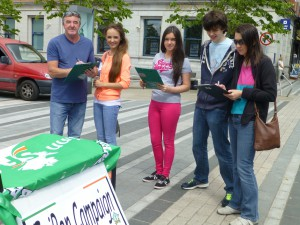 Caoilbhfiona, Sophie and Oilibhéar collect signatures in Dundalk